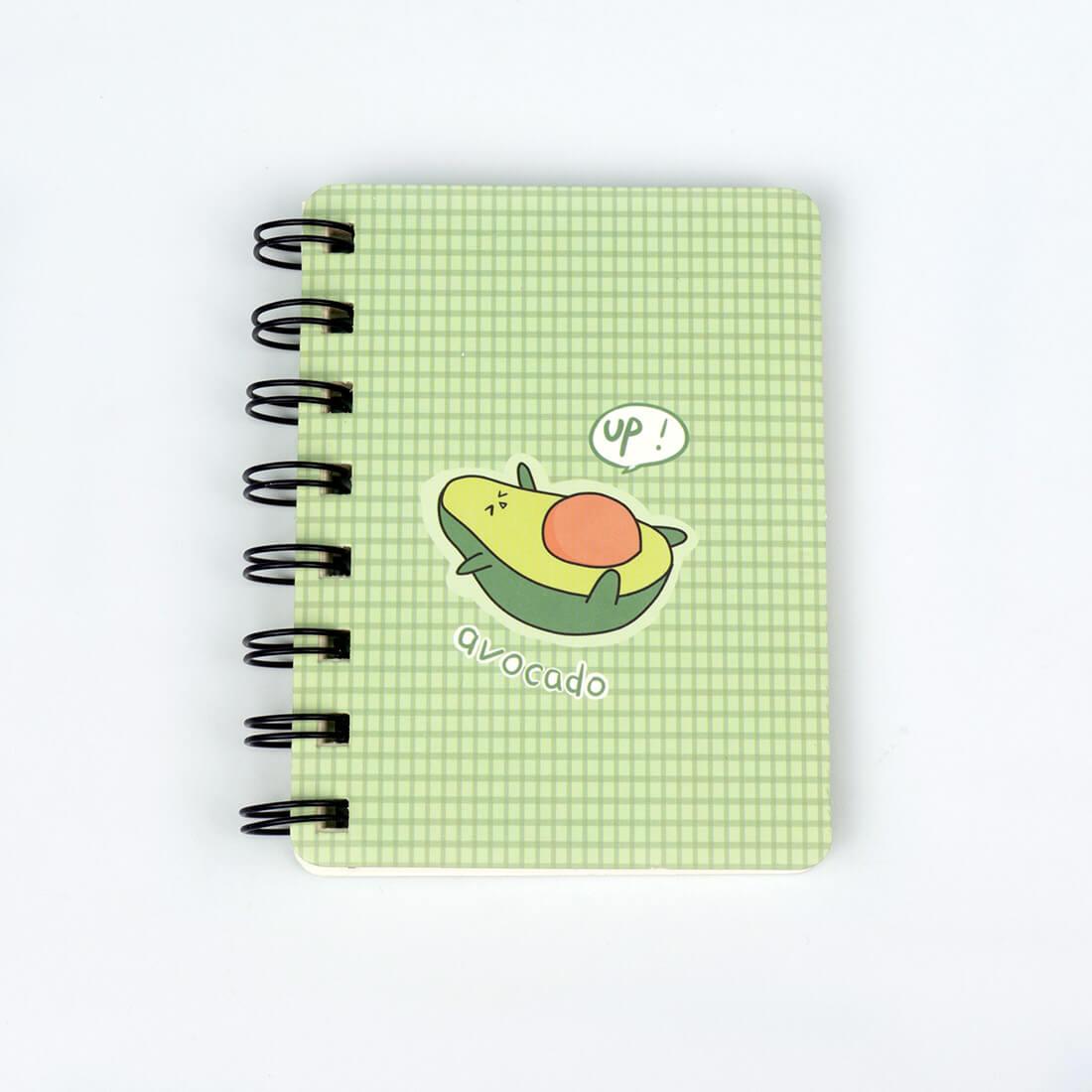 notizbuch liegende avocado